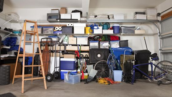 A garage that has a large amount of waste ready to be disposed off by our team